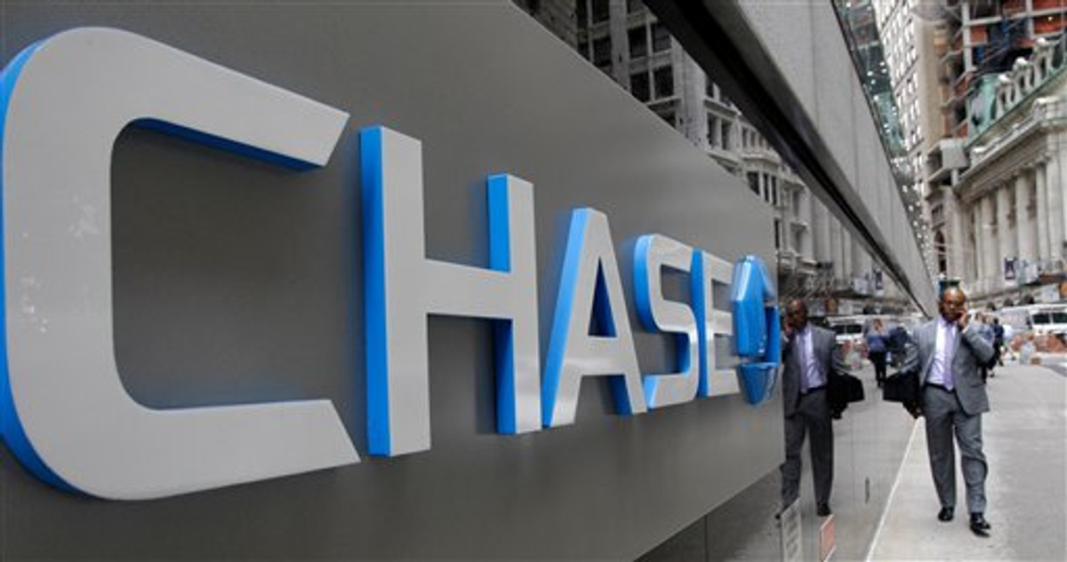 This Oct. 12, 2011 file photo shows the J.P. Morgan Chase logo at the base of one of the bank's larger Lower Manhattan buildings in New York    (AP Photo/Kathy Willens)