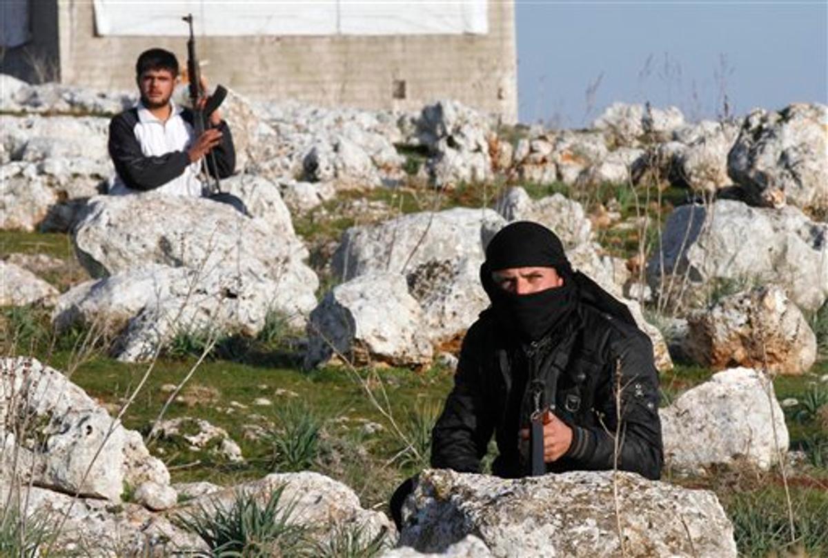 Syrian rebels are seen outside of Idlib, Syria, Saturday, Feb. 11, 2012 (AP)
