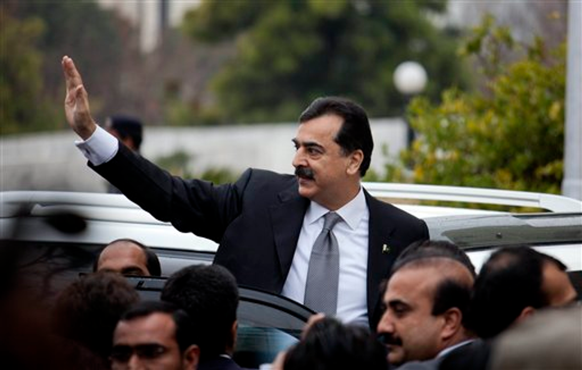 Pakistani Prime Minister Yousuf Raza Gilani waves upon his arrival at the Supreme Court for a hearing in Islamabad, Pakistan, Monday, Feb. 13, 2012 (AP Photo/B.K. Bangash)