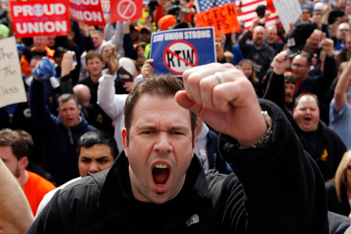 Protest greeted Indiana Senate's approval of right-to-work bill this week.        (AP/Michael Conroy)