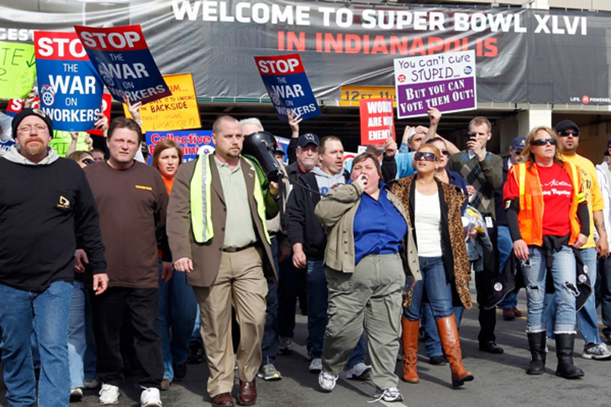 Muted union protestors in the Super Bowl Village on Sunday.         (AP/Michael Conroy)