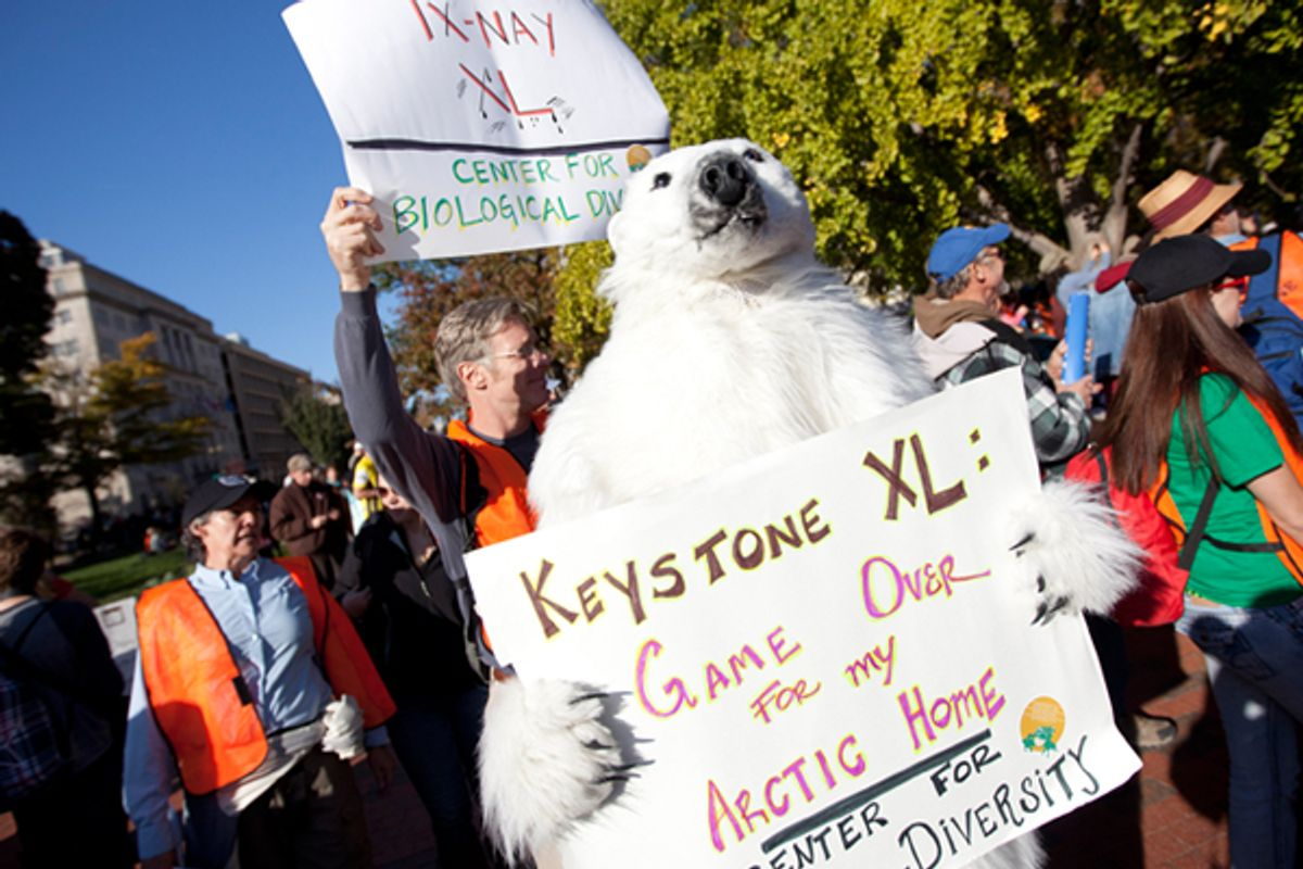 Protestors outside the White House demand a stop to the Keystone XL tar sands oil pipeline.       (AP/Evan Vucci)