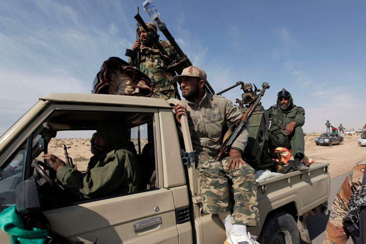 Libyan rebels head towards the front line outside the eastern town of Brega, Libya Friday, April 1, 2011       (AP)