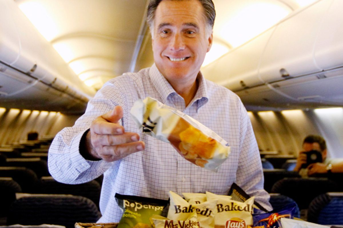 Mitt Romney throws bags of chips at traveling reporters on his campaign charter plane.       (AP/Charles Dharapak)