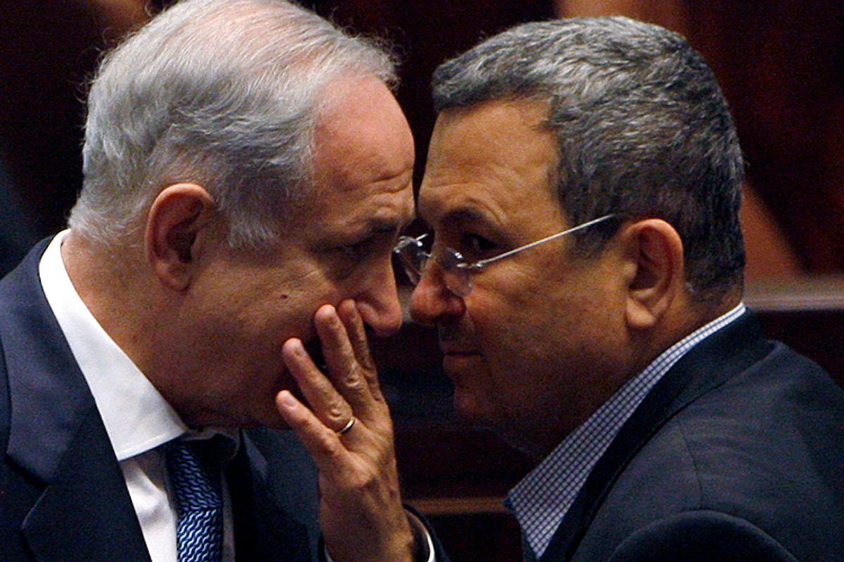 Israeli Prime Minister Benjamin Netanyahu speaks with Defense Minister Ehud Barak      (Ronen Zvulun / Reuters)