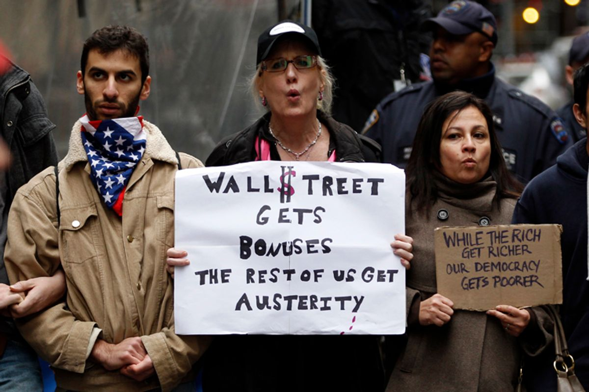 """Occupy Wall street demonstrators near the New York Stock Exchange during what organizers called a """"Day of Action"""" in New York, November 17, 2011.      (Mike Segar / Reuters)"""