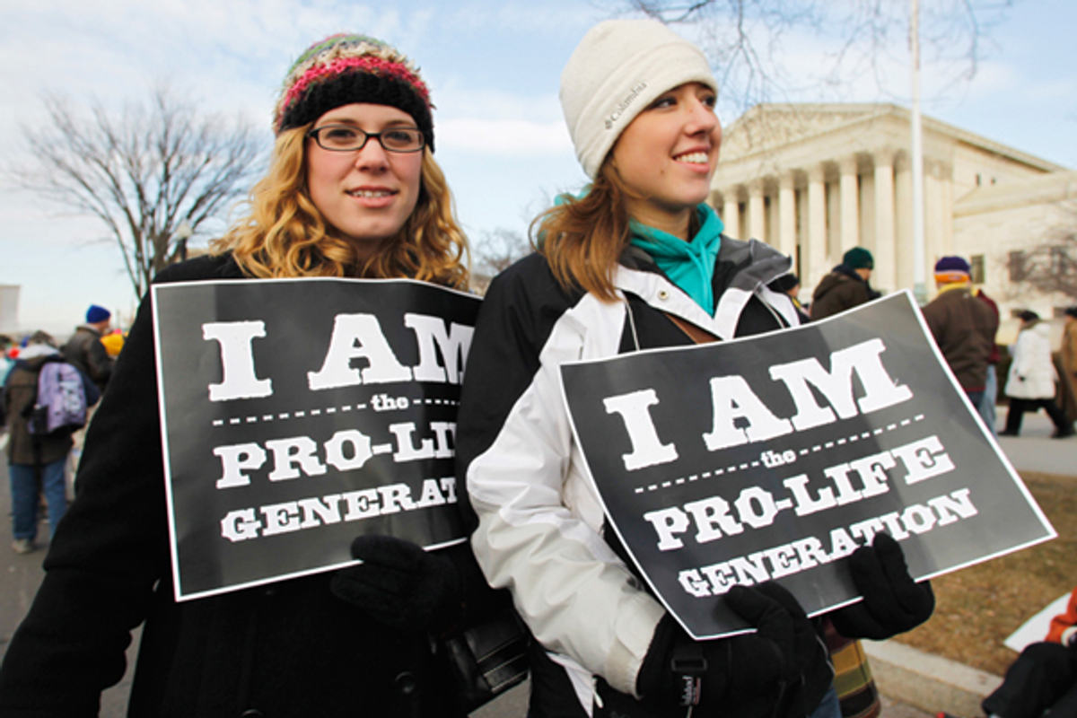 Anti-abortion activists march in front of the Supreme Court in Washington, Monday, Jan. 24, 2011       (AP/Manuel Balce Ceneta)