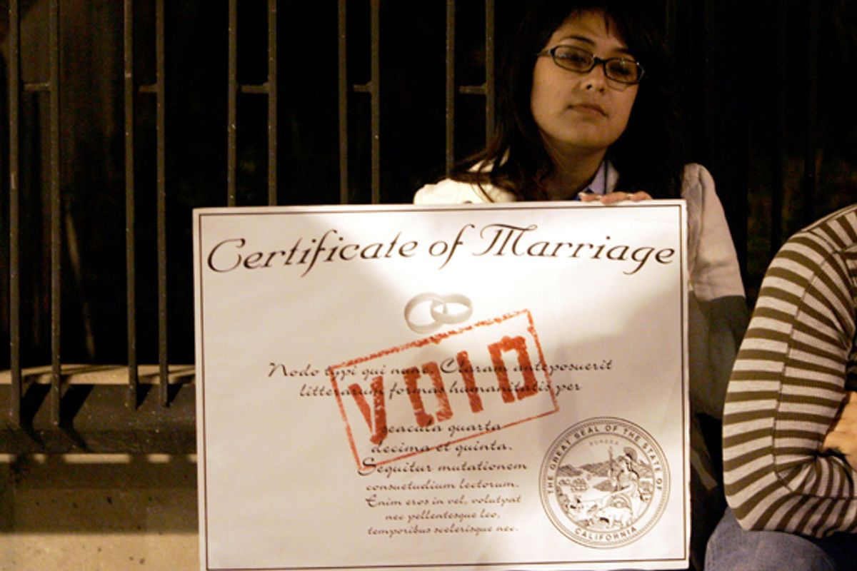 A protester holds a mock marriage certificate while demonstrating during an anti-Proposition 8 rally in Los Angeles.   (Reuters/Danny Moloshok)
