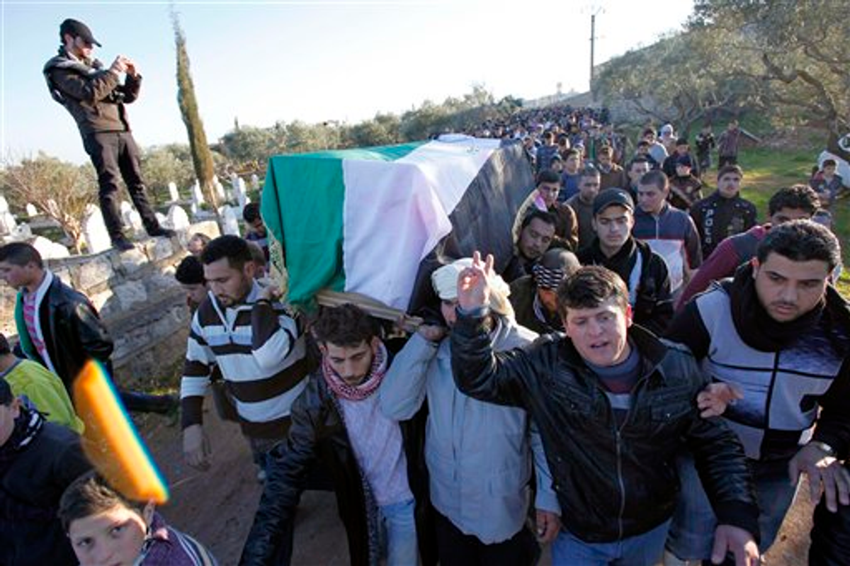 In this Saturday, Feb. 4, 2012 photo anti-government protesters carry the coffin of a slain proteste in Idlib, north Syria      (AP)