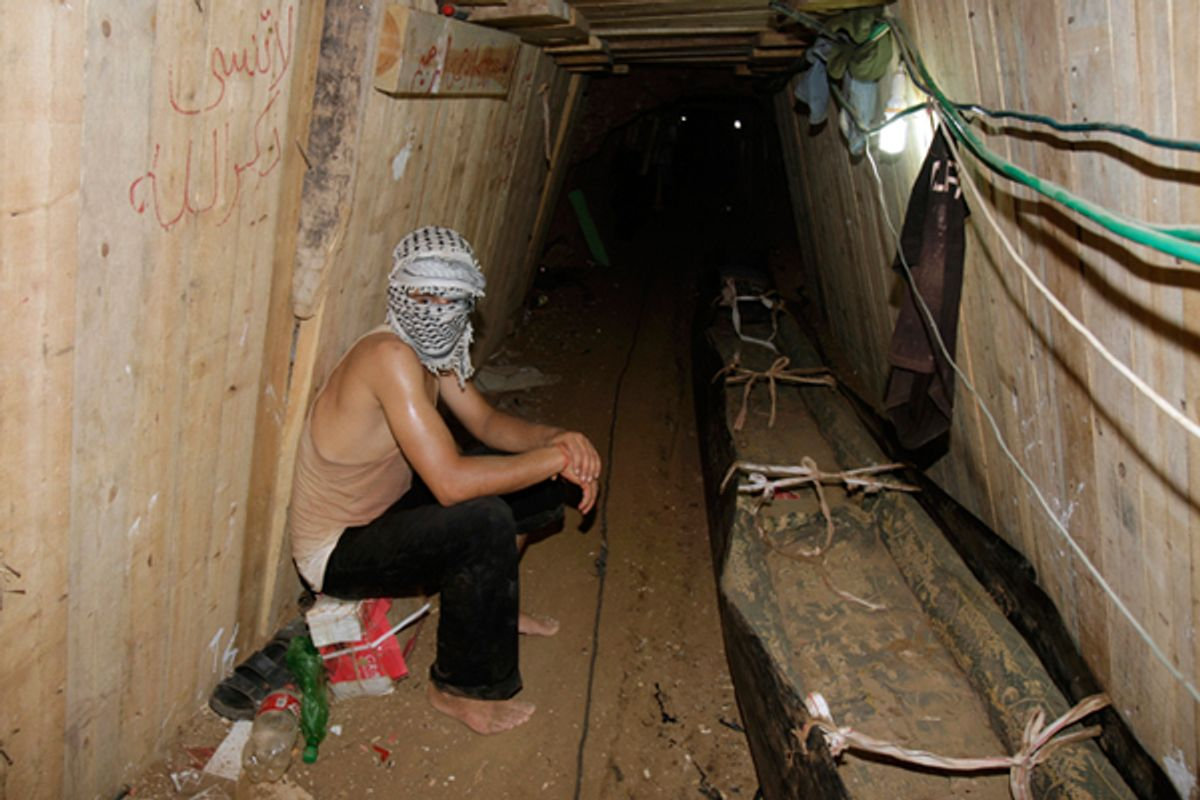 A Palestinian sits in a smuggling tunnel beneath the Egyptian-Gaza border in Rafah.  (Reuters//Ibraheem Abu Mustafa)