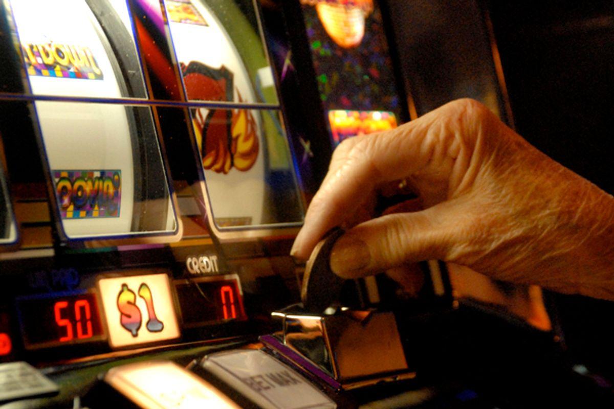 A player puts a dollar coin in an Atlantic City slot machine        (AP)