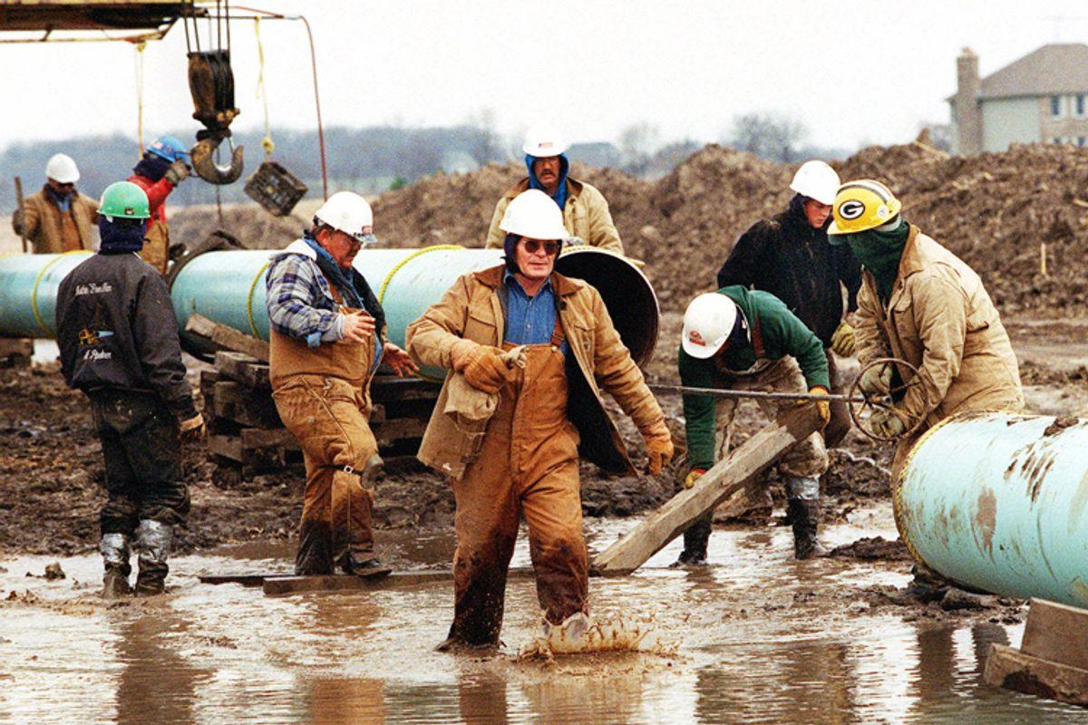 "Members of the ""chain gang"" assemble a pipeline near Burlington, Ill.             (AP)"