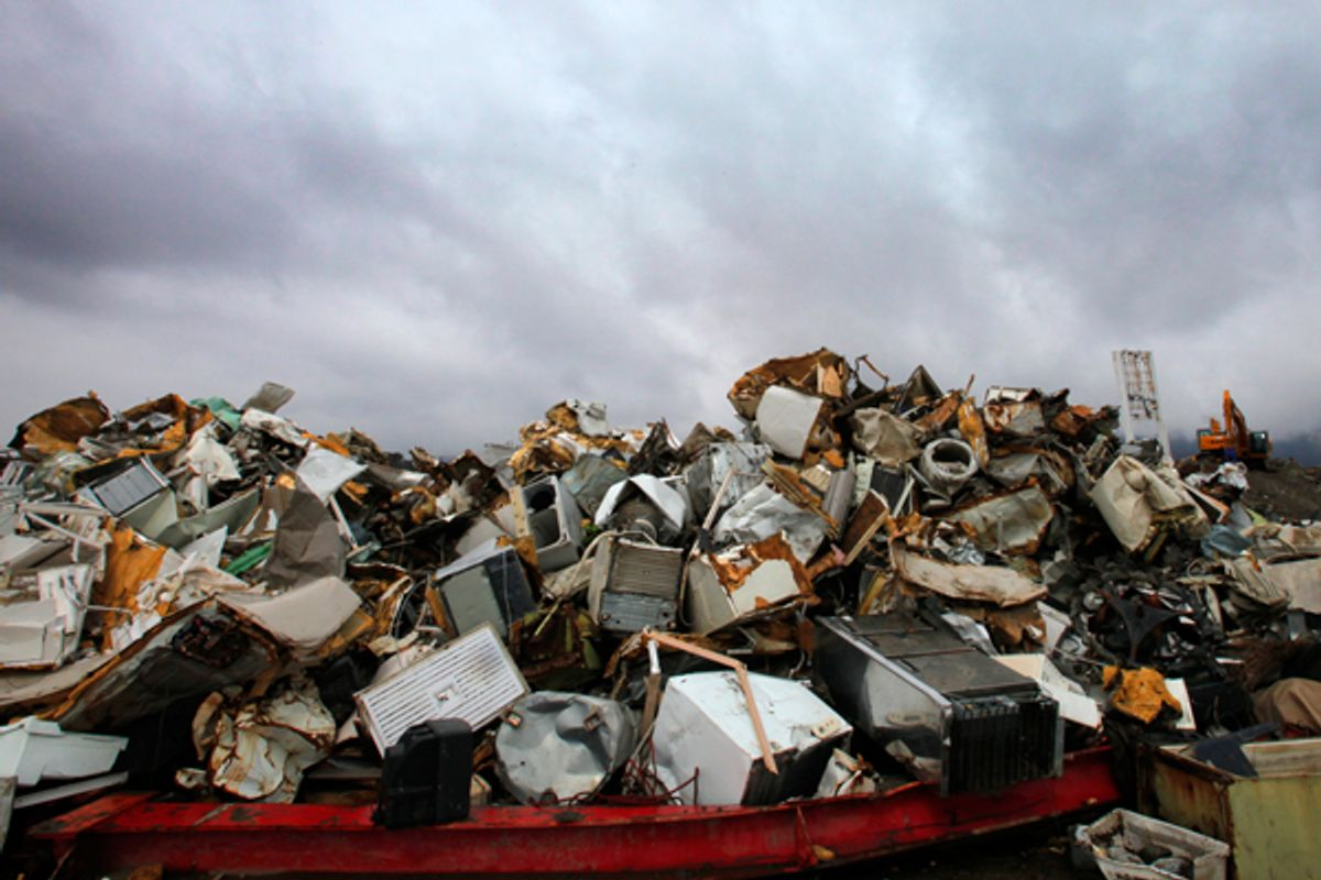 Debris left by the 2011 tsunami is piled up in Ofunato, Iwate Prefecture, northeastern Japan. Tsunami debris is now washing up on the West Coast of the U.S.       (AP/Itsuo Inouye)