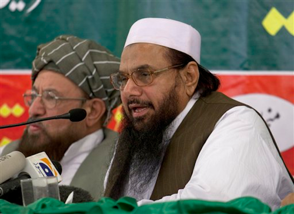 Hafiz Mohammad Saeed, right, chief of Jamaat-ud-Dawwa and founder of Lashkar-e-Taiba, addresses a news conference with anti-American cleric Sami ul Haq in Rawalpindi, Pakistan on Wednesday, April 4, 2012.    (AP Photo/B.K. Bangash)