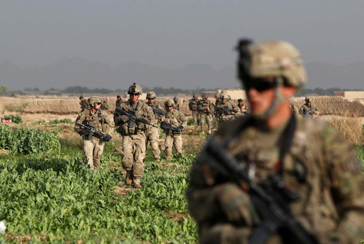 U.S. Army soldiers from 4-73 Cavalry Regiment, 82nd Airborne Division walk during a mission in Zhary district of Kandahar province, southern Afghanistan April 17, 2012 (REUTERS/Baz Ratner)
