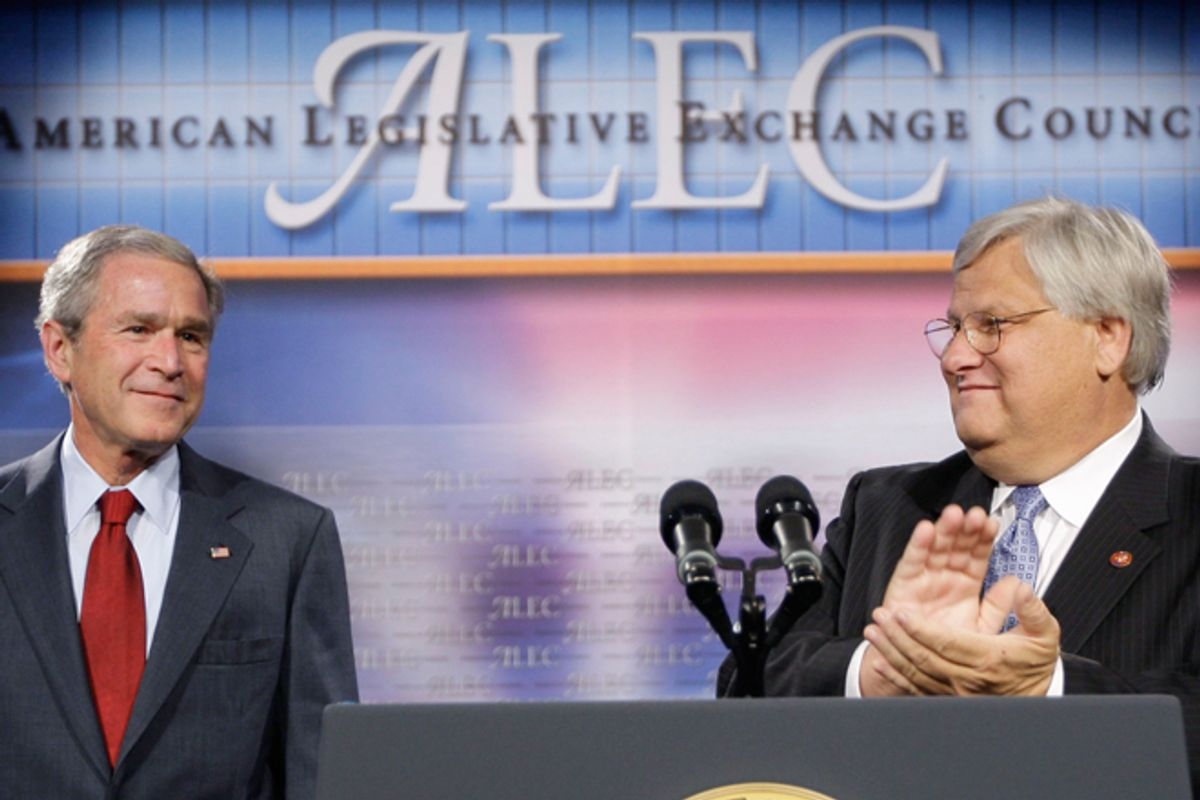 President George W. Bush, left, is introduced by Rep. Kenny Marchant prior to speaking at the American Legislative Exchange Council in 2007.  (AP/Pablo Martinez Montsivais)
