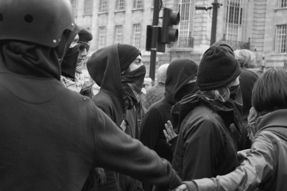 A Black bloc protest in London.     (<span about='http://www.flickr.com/photos/alightbourne/5613721669/' xmlns:cc='http://creativecommons.org/ns#'><a href='http://www.flickr.com/photos/alightbourne/with/5613721669/' rel='cc:attributionURL' target='_blank'>alightman</a> / <a href='http://creativecommons.org/licenses/by/3.0/' rel='license' target='_blank'>CC BY 3.0</a></span>)