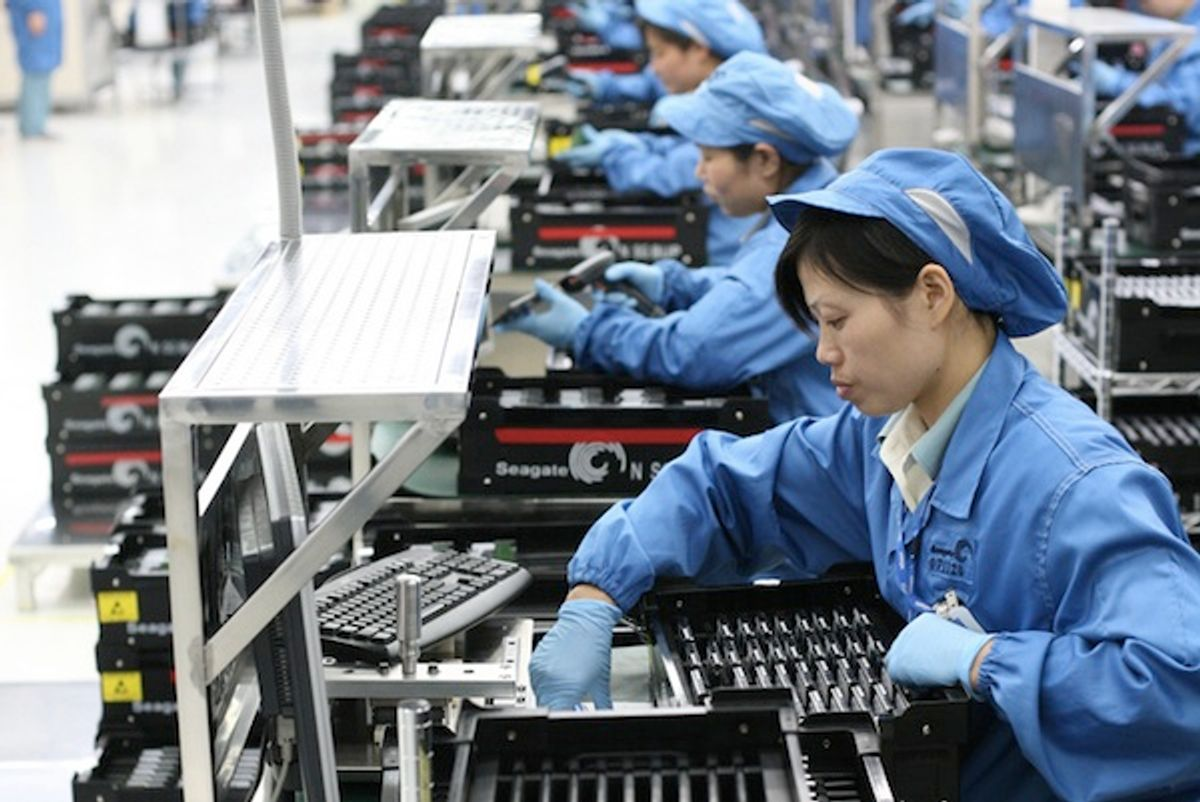 Workers at a Seagate Wuxi factory in China       (<span about='http://www.flickr.com/photos/scobleizer/3009516045/' xmlns:cc='http://creativecommons.org/ns#'><a href='http://www.flickr.com/photos/scobleizer/' rel='cc:attributionURL' target='_blank'>Robert Scoble</a> / <a href=http://creativecommons.org/licenses/by/2.0' rel='license' target='_blank'>CC BY 2.0</a></span>)