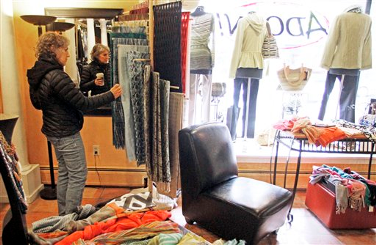 In this Feb. 28, 2012, Laurie Hanson looks over clothing at the Adorn clothing store in Montpelier, Vt.   (AP Photo/Toby Talbot)