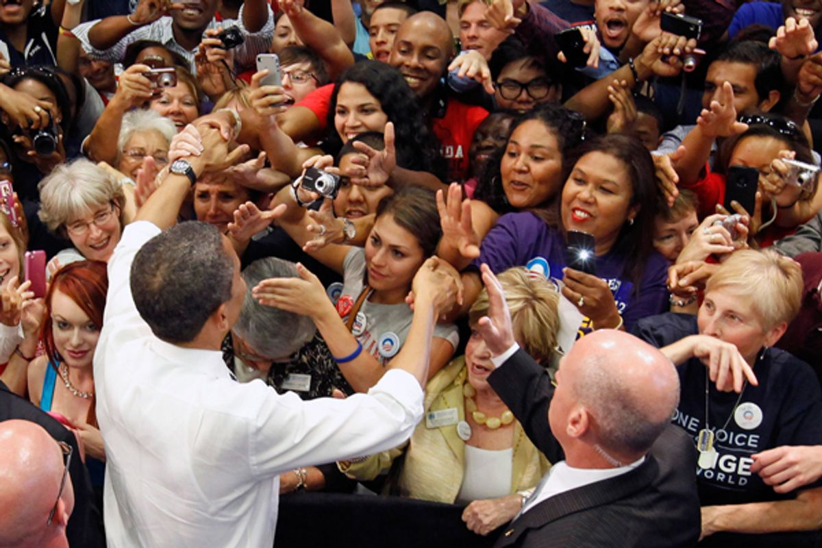President Obama shakes hands with supporters after speaking about tax fairness and the economy in Boca Raton, Florida, on Tuesday.    (Reuters/Kevin Lamarque)
