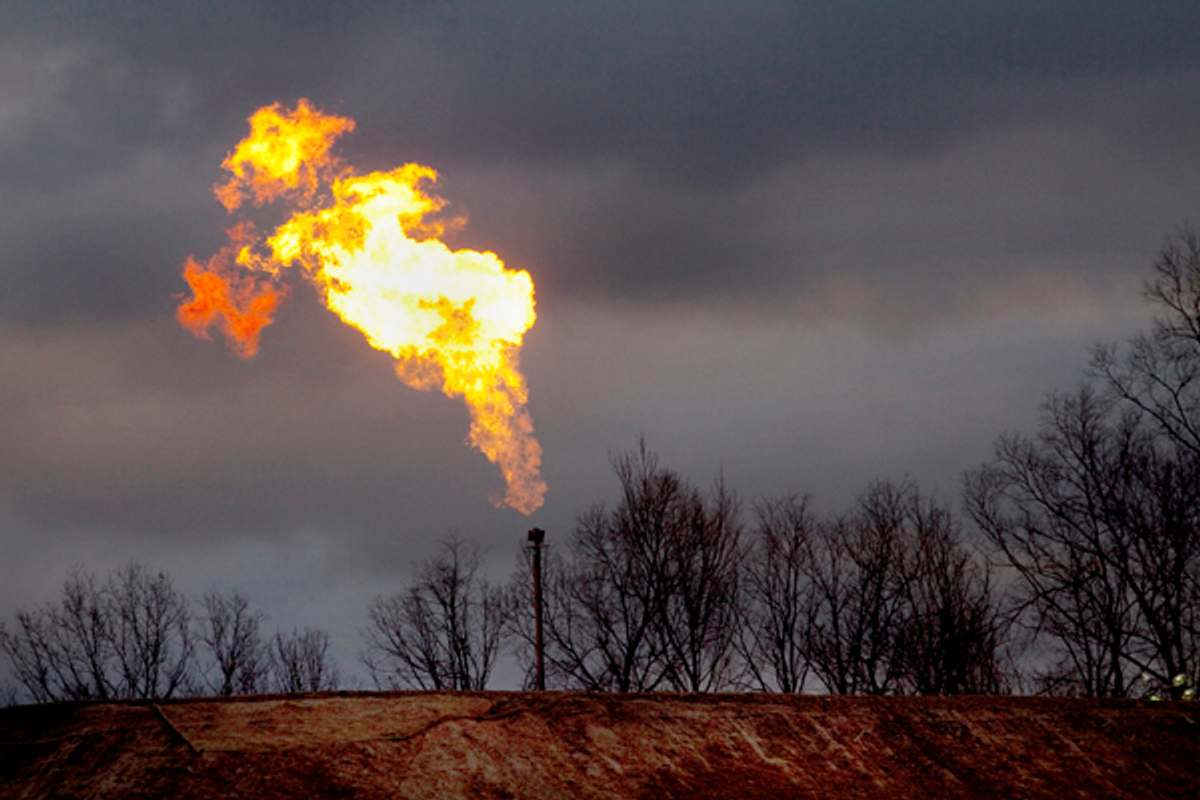 A gas flare burns at a fracking site in rural Bradford County, Pennsylvania January 9, 2012       (Reuters/Les Stone)