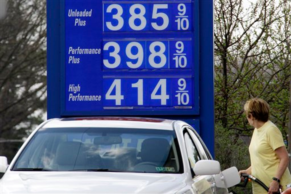 In this March 19, 2012, photo, a motorist pumps gas at a Mount Lebanon, Pa., mini-mart     (AP Photo/Gene J. Puskar)