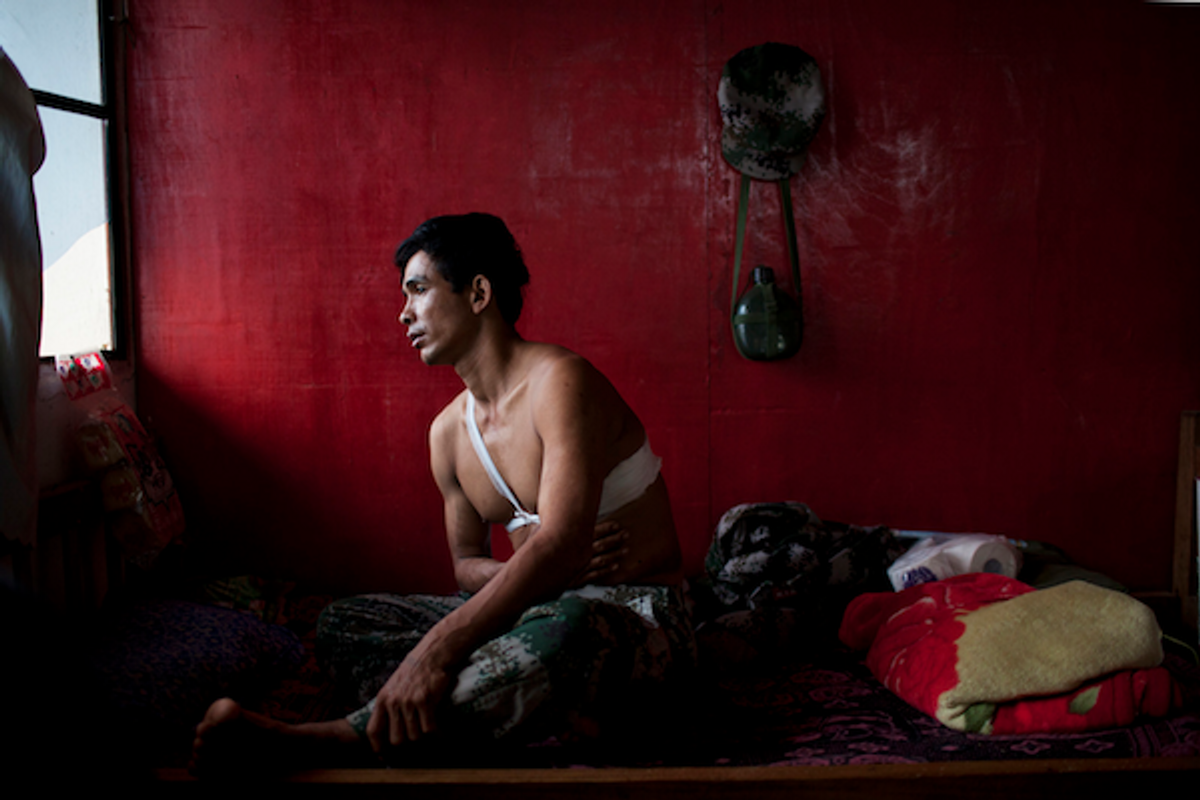 Saw Htet Aung, a 42-year-old soldier in the Kachin Independence Army, recovers at Laiza Military Hospital, near Laiza, Burma, March 30, 2012. Saw Htet Aung was shot in the torso while on patrol in Ban Dawng, on March 21, 2012.    (Will Baxter/GlobalPost)
