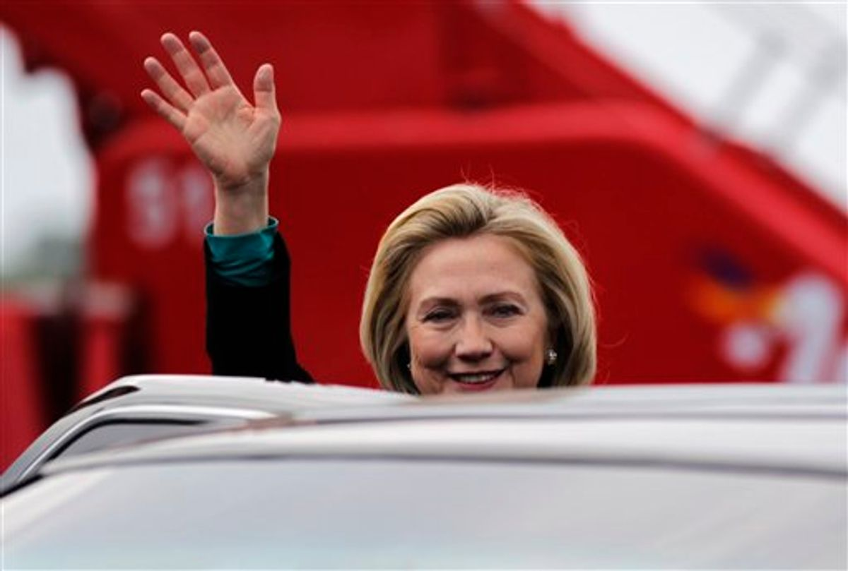 U.S. Secretary of State Hillary Clinton waves as she arrives at the airport in Cartagena, Colombia Friday April 13, 2012. Leaders of the western hemisphere will attend the 6th Summit of the Americas in Cartagena this weekend. (AP Photo/John Vizcaino, Pool)     (AP)