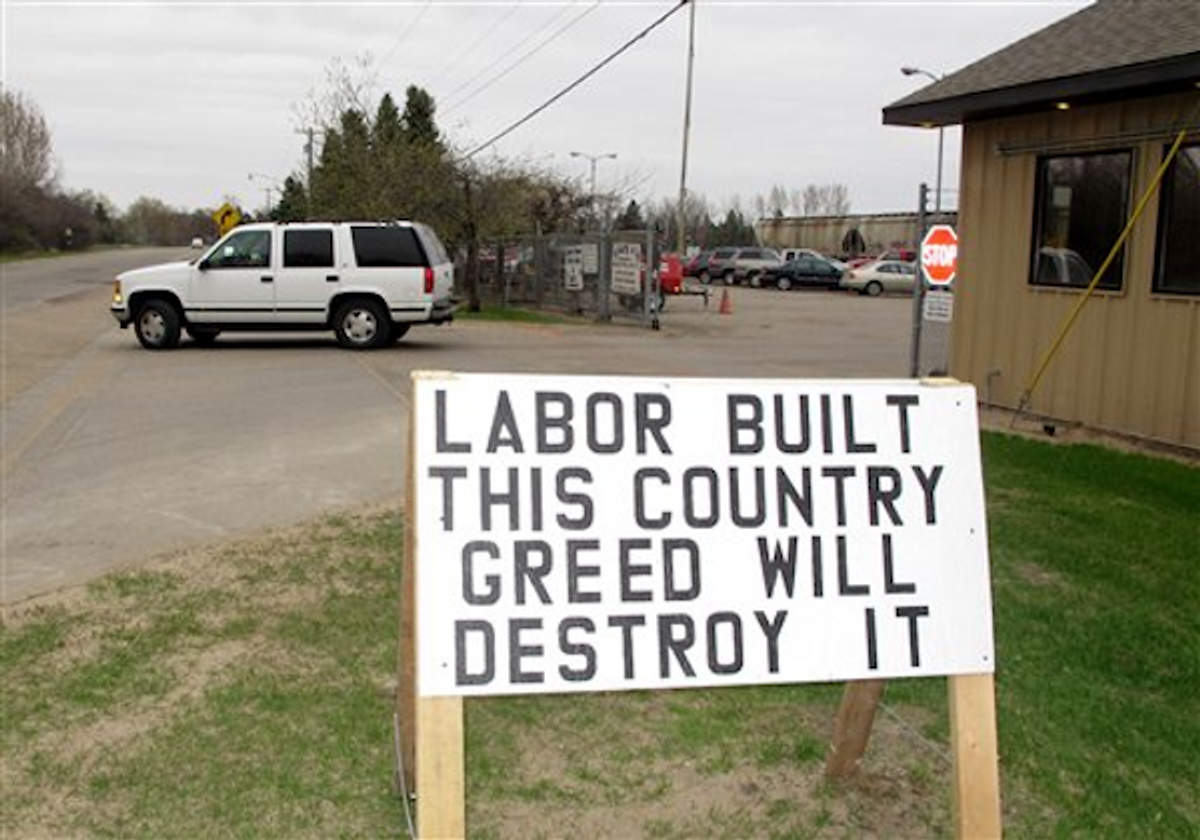 A pro-labor sign is posted outside the entrance of the American Crystal Sugar Co. plant in Moorhead, Minn., Monday, April 2, 2012        (AP Photo/Dave Kolpack)