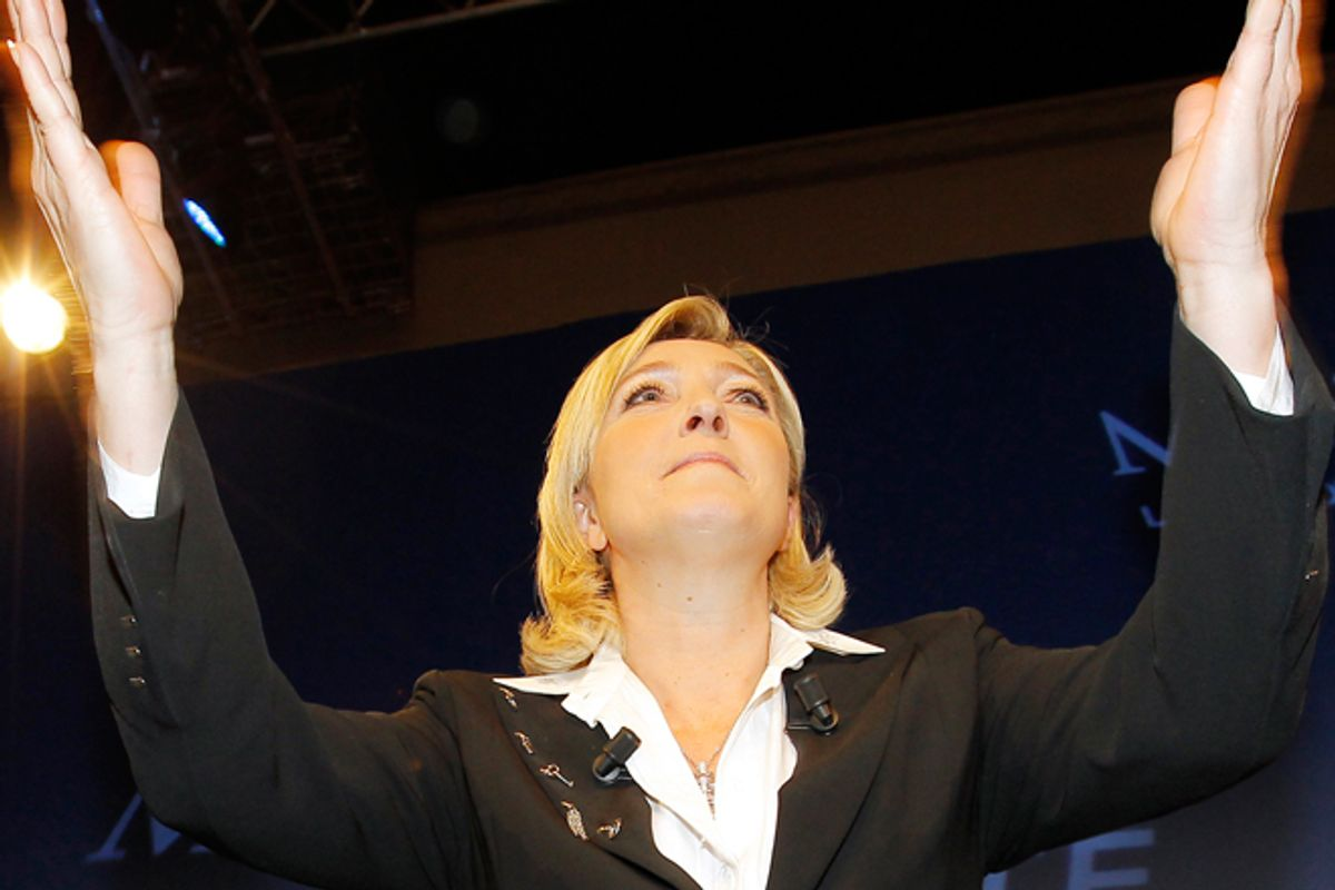 Marine Le Pen reacts after the first round of French presidential elections on Sunday.    (AP/Jacques Brinon)