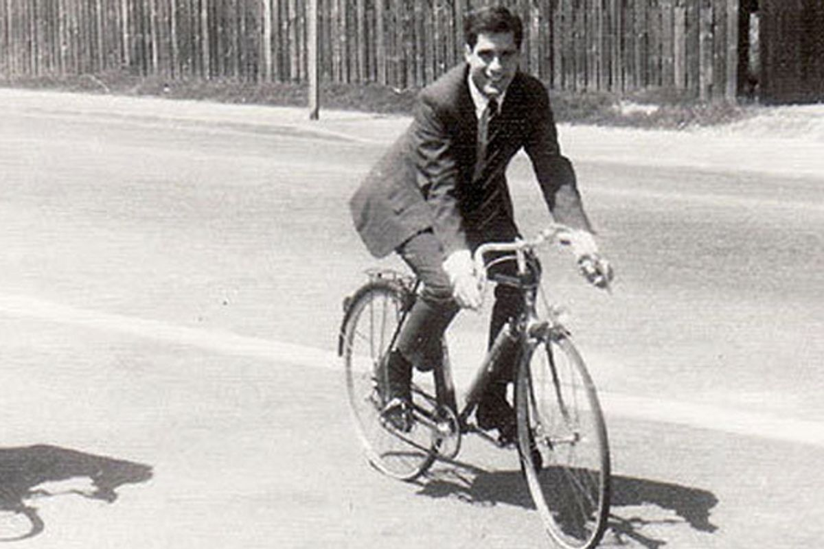 A young Romney rides a bicycle in France.   (André Salarnier)