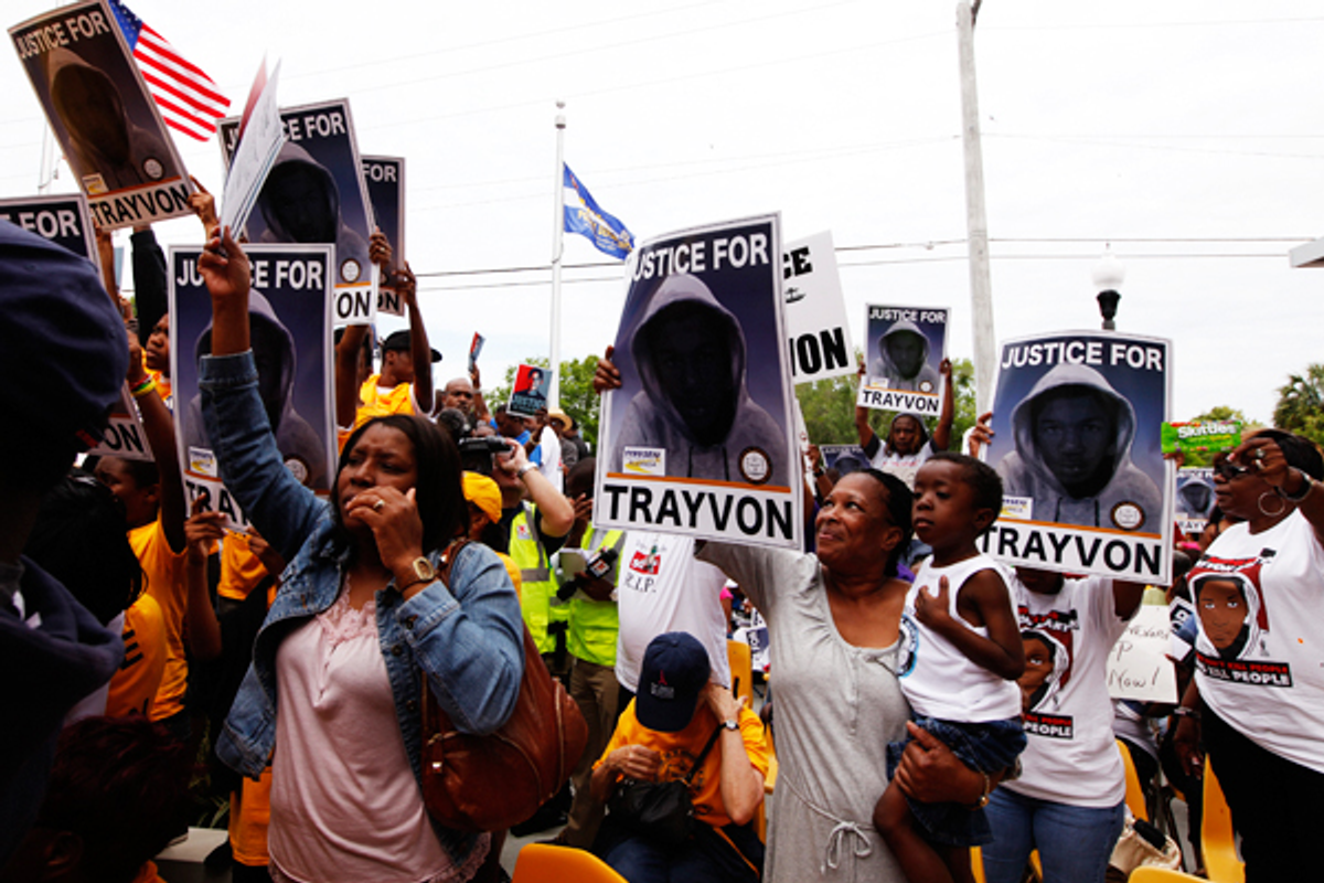 Demonstrators hold signs during a march to the front of the Sanford Police Department for Trayvon Martin in Sanford, Florida, March 31, 2012          (Reuters/Lucas Jackson)
