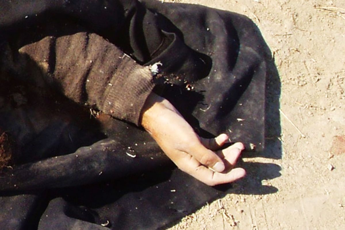 """The hand of a combatant killed in Afghanistan, taken from the author's personal stash of """"war porn.""""      (John Rico)"""