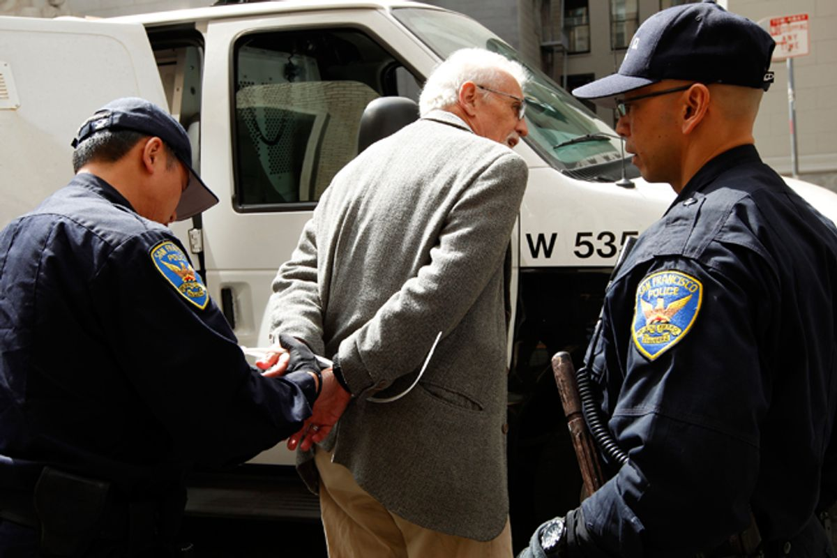 San Francisco police arrest a demonstrator during a protest outside of a Wells Fargo shareholders meeting on Tuesday.     (Reuters/Robert Galbraith)