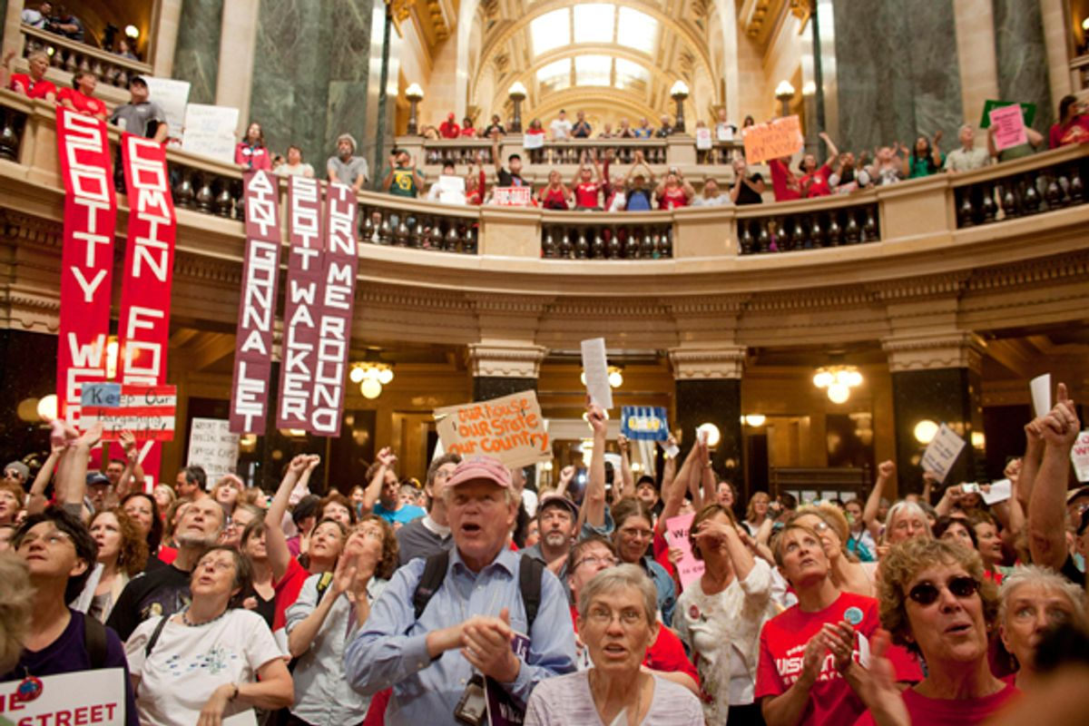 Protesters at the Wisconsin state capitol building (Reuters/Darren Hauck)