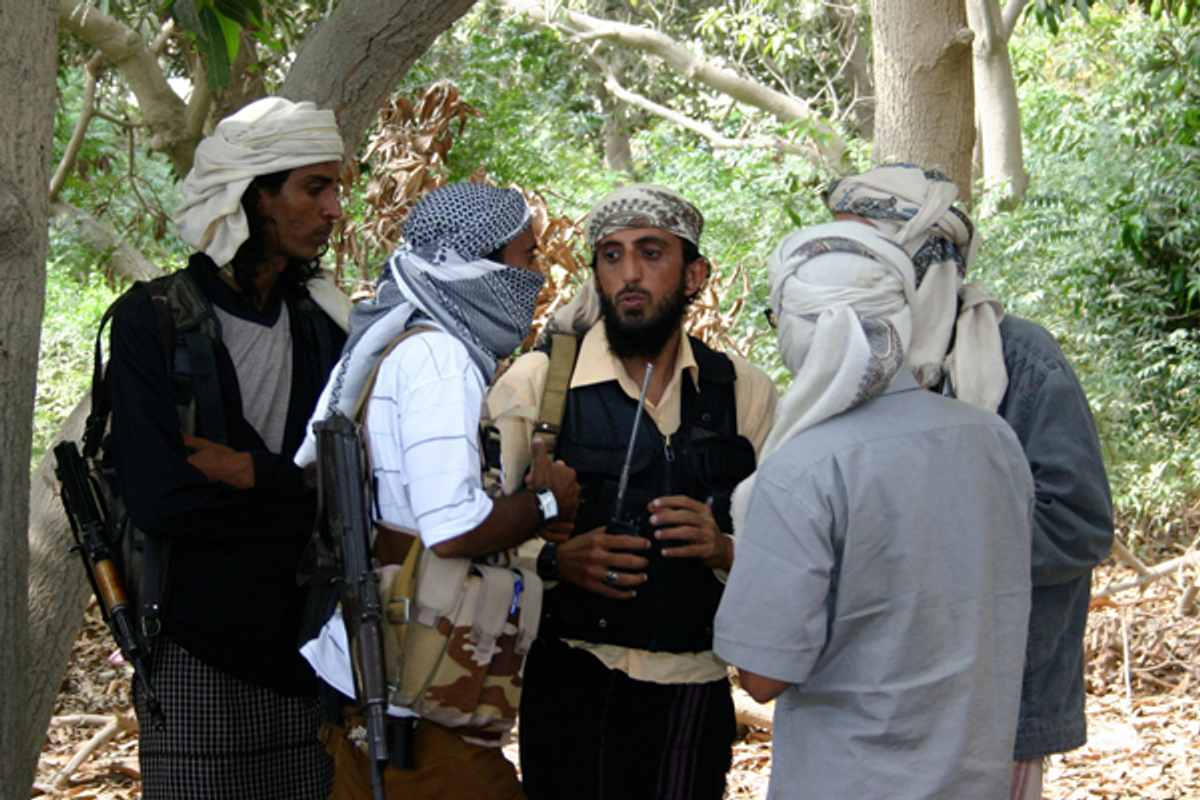 Members of a group affiliated with Al-Qaida talk in the southern Yemeni city of Zinjibar January 21, 2012     (Reuters)