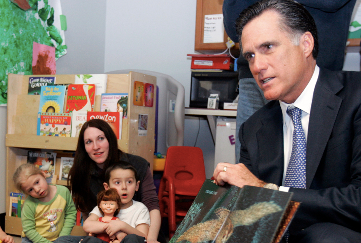 Republican presidential candidate and former Massachusetts Governor Mitt Romney reads a book to children in Manchester (Brian Snyder / Reuters)
