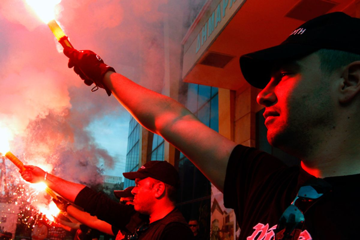 Members of the Greek extreme right Golden Dawn party hold an election rally.       (Reuters/Yannis Behrakis)
