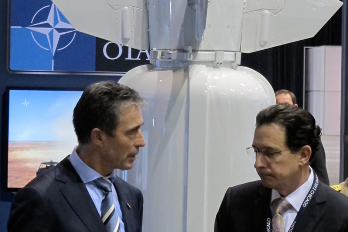 NATO Secretary General Anders Fogh Rasmussen speaks with a defense-industry official at the Chicago summit.  (Alexander Zaitchik)