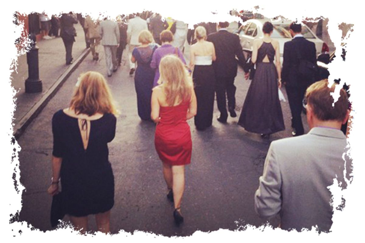The author in a red dress in a Second Line processional through the French Quarter.       (Laurence Kretchmer)