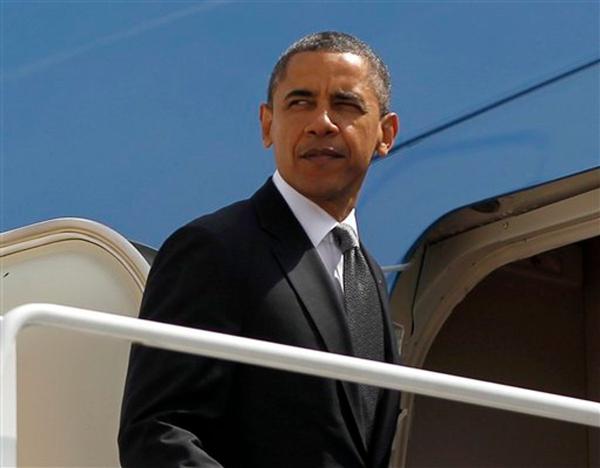 President Barack Obama prepares to board Air Force One before his departure from Andrews Air Force Base, Tuesday, May, 8, 2012. (AP Photo/Pablo Martinez Monsivais)       (AP)