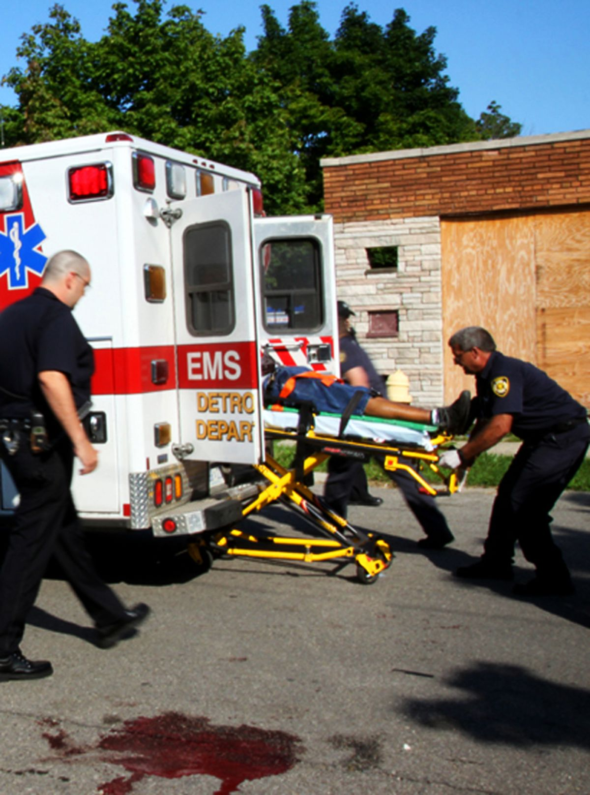 Medics rush a fatally wounded shooting victim to the hospital at Morang and Somerset in Detroit.       (Amber Hunt)
