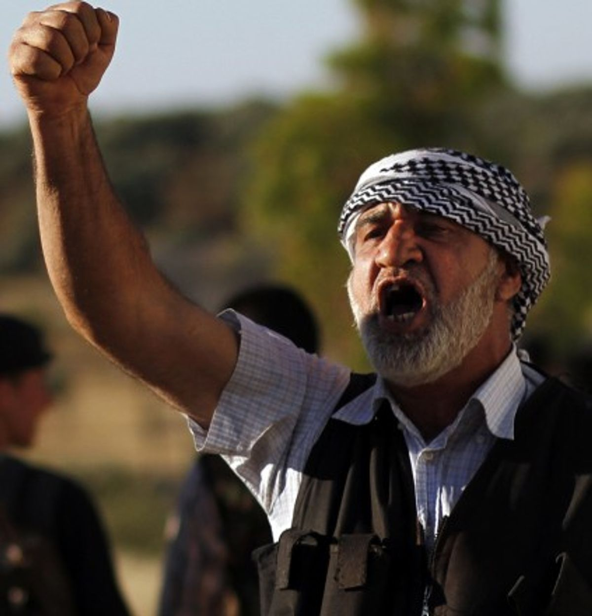 A Free Syrian Army officer chants slogans during a training session on the outskirts of Idlib, Syria.    (Associated Press)
