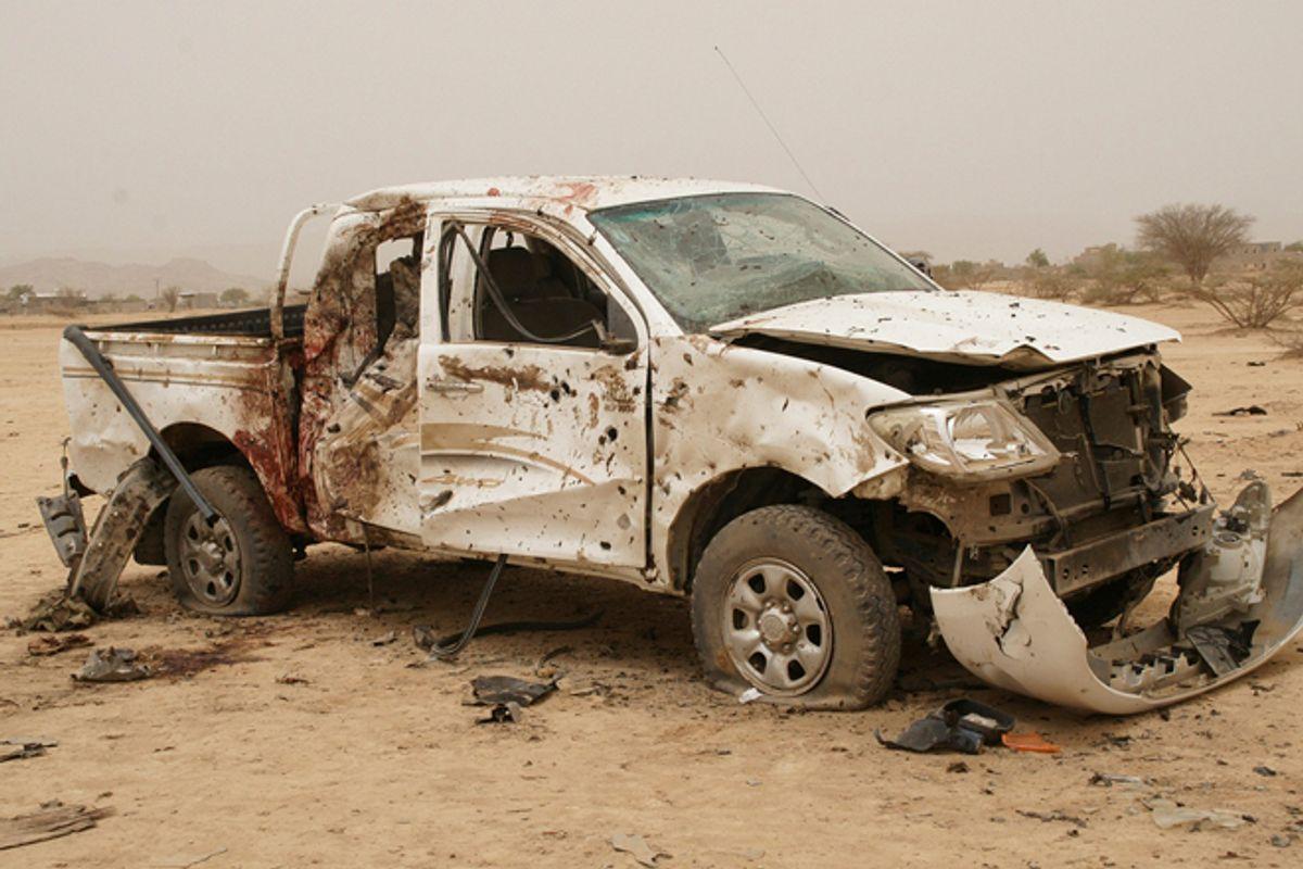A destroyed vehicle allegedly belonging to al Qaeda-linked militants in Abyan, Yemen.         (Reuters)
