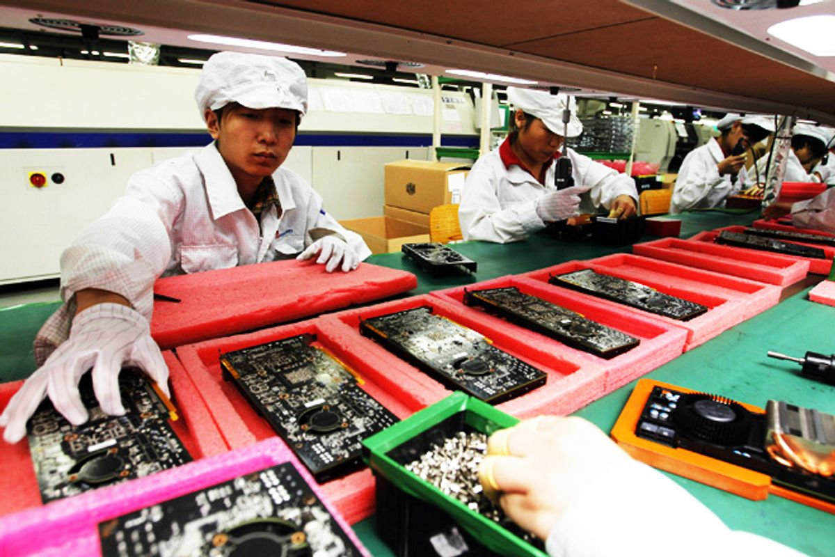 Staff members work on the production line at the Foxconn complex in Shenzhen, China.           (AP/Kin Cheung)
