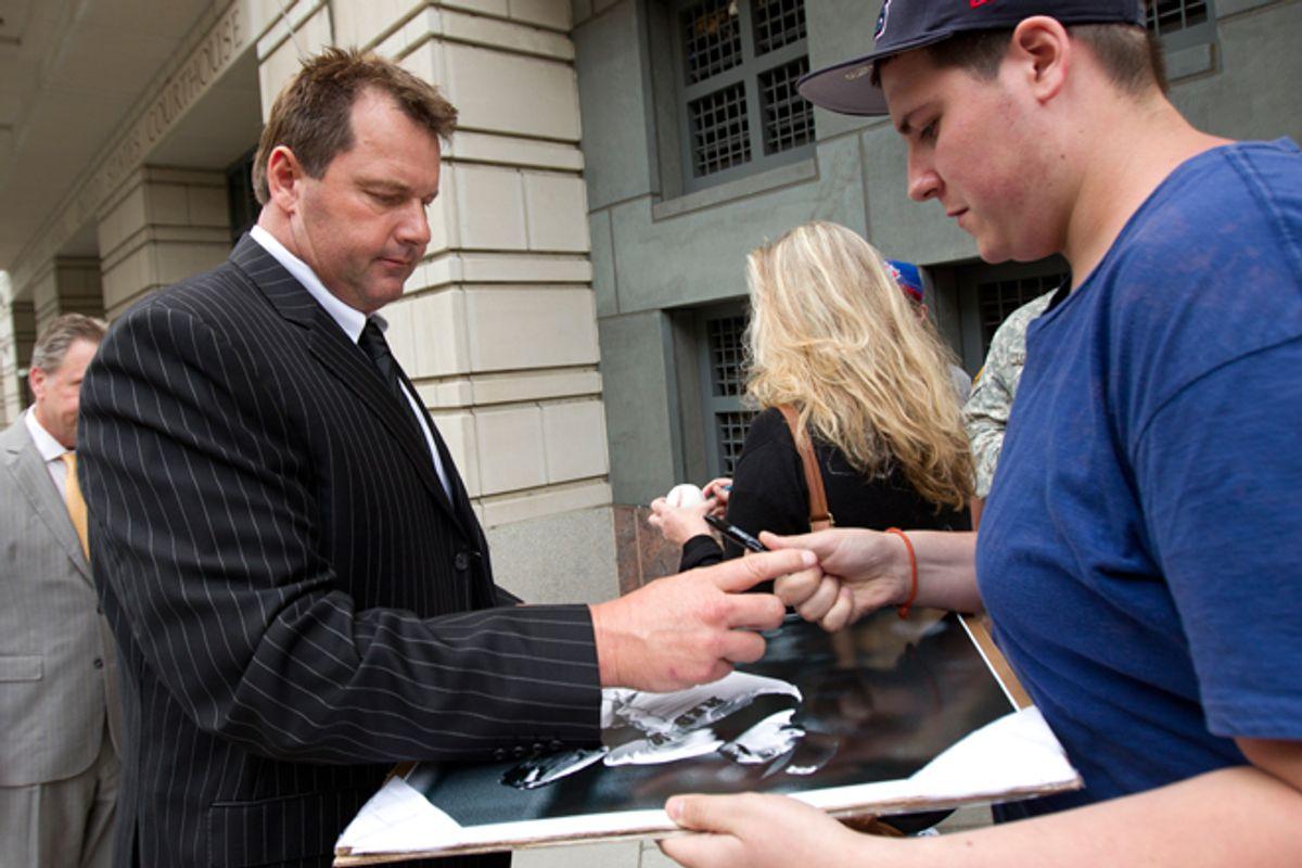 Roger Clemens signs autographs as he leaves federal court on June 5.     (AP/Manuel Balce Cenata)