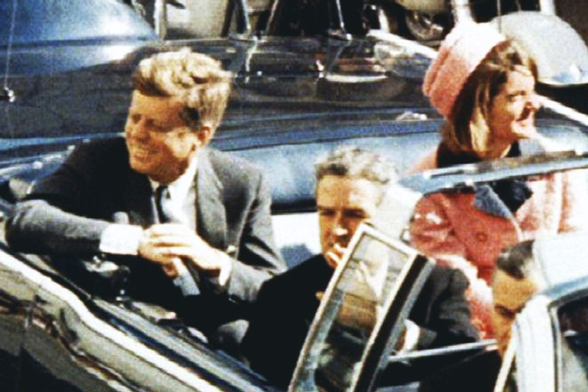 President and Mrs. Kennedy ride through Dallas moments before Kennedy was assassinated on November 22, 1963.    (Reuters)