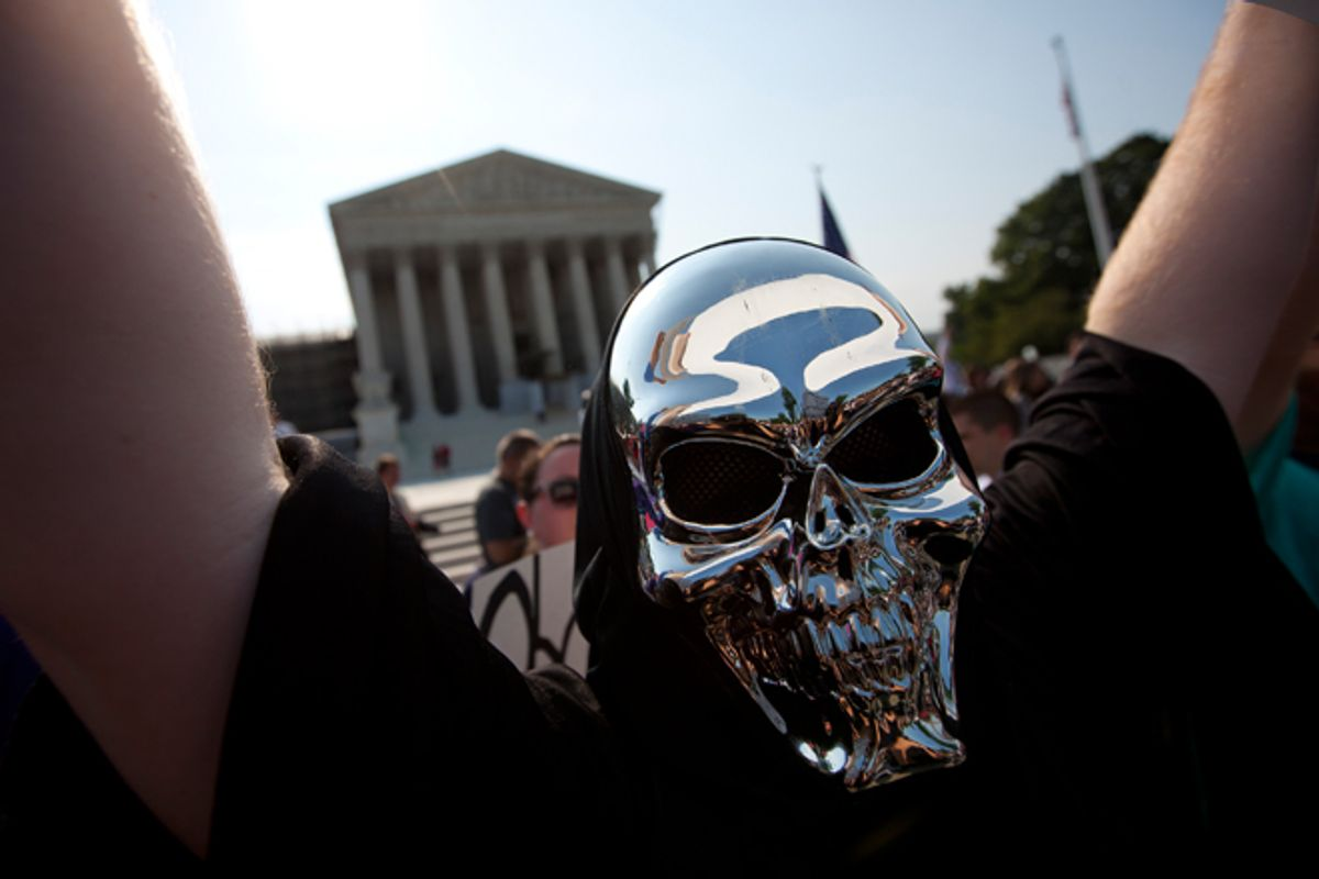 A demonstrator outside the Supreme Court on Thursday.           (AP/Evan Vucci)