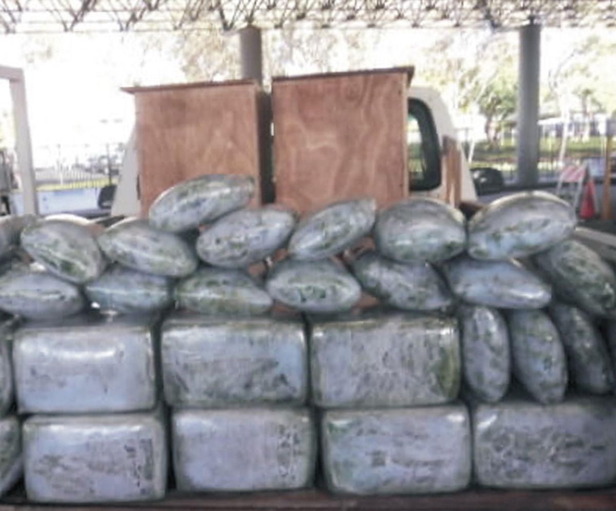 TO GO WITH NARCOTRAFICO AVISOS - This Sept. 7, 2010, photo provided by the U.S. Immigration and Customs Enforcement shows more than 110 kg of marijuana seized from a vehicle that attempted to enter the U.S. near San Diego. The driver of this vehicle had stated he responded to a newspaper ad allegedly placed by drug smugglers to recruit drivers to unwittingly take drugs across the border. Smugglers are advertising in Mexican newspapers for jobs as security guards, housecleaners and cashiers to recruit the unemployed and underemployed to drive drug-laden vehicles into the United States. Starting this week in April 2012, U.S. Immigration and Customs and Enforcement began warning job applicants in two Tijuana newspapers that they may be unwitting targets for drug cartels. (AP Photo/U.S. Immigration and Customs Enforcement)   (Associated Press)