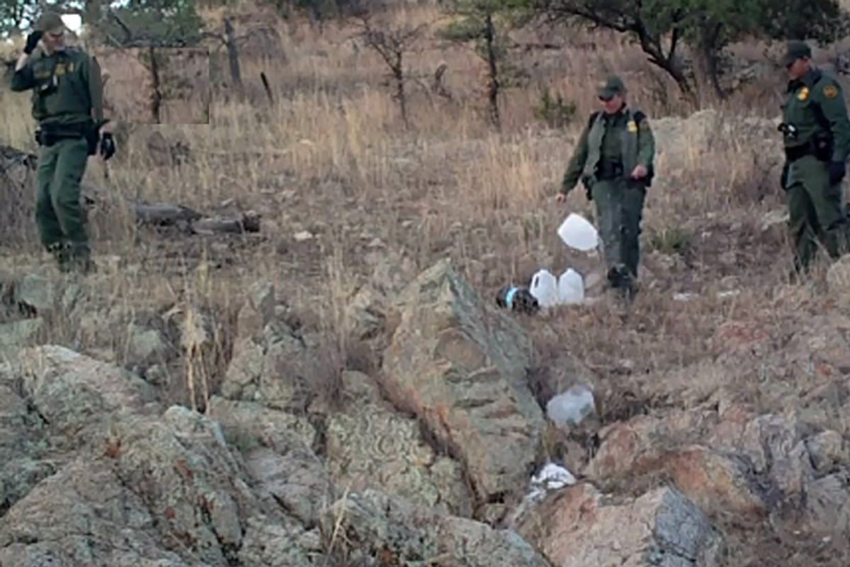 """A hidden camera set up by the group No More Deaths shows Border Patrol agents destroying water left in the desert for migrants to drink. The video will be broadcast tonight on the PBS show """"Need to Know."""""""